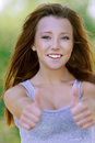 Smiling young woman showing gesture Royalty Free Stock Photo