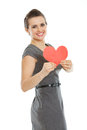 Smiling young woman showing heart shaped postcard Stock Photo