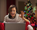 Smiling young woman showing ok gesture while having video chat Royalty Free Stock Photo