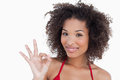 Smiling young woman showing the ok sign Stock Images