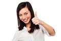 Smiling young woman showing thumbs up keep the great work our business team loves you Royalty Free Stock Photography