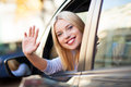 Smiling young woman sitting in car Royalty Free Stock Images