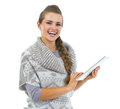 Smiling young woman in sweater using tablet pc isolated on white Royalty Free Stock Images