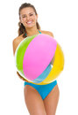 Smiling young woman in swimsuit with beach ball Royalty Free Stock Photo