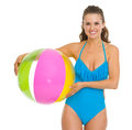 Smiling young woman in swimsuit holding beach ball Royalty Free Stock Photo