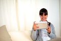 Smiling young woman using her tablet pc Royalty Free Stock Photography