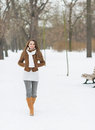 Smiling young woman walking in winter park with long hair Royalty Free Stock Images