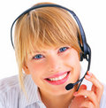 A smiling young woman wearing headset Stock Images