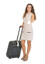 Smiling young woman with wheels suitcase  Stock Images