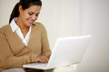 Smiling young woman working with laptop computer Royalty Free Stock Photo