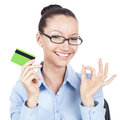 Smilling businesswoman with credit card in hand on workplace Royalty Free Stock Image