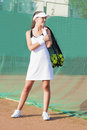 Smilling Female Tennis Woman Holding Tennis Mesh Bag with Balls Stock Photo