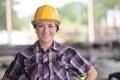 Smily female worker wearing yellow helmet Royalty Free Stock Photo