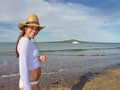 Smily new zealand girl cheerful on the beach Stock Images