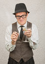 Smirking drunk man awkward tipsy business with cigarette and martini Royalty Free Stock Image