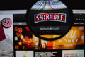 Smirnoff vodka photo of homepage on a monitor screen through a magnifying glass Royalty Free Stock Image