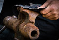 The smith and the leaf of steel blacksmith is working a Royalty Free Stock Images
