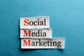 Smm abbreviation social media marketing on blue paper Stock Image