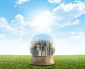 Smog city snowglobe a snow globe with a surrounded by pollution and on a perfect flat green lawn against a blue sky with white Stock Photos