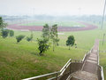 Smog over sports stadium deserted open air as people seek shelter indoors as the situation in singapore gets worse with the Stock Photo