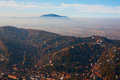 Smog rising above city brasov city houses and hills Royalty Free Stock Images