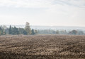 Smog in a village small with brown field Stock Image