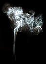 Smoke on a black background in abstract mushroom shape Stock Photography