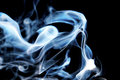 Smoke blue swirl on black background Royalty Free Stock Photos
