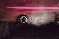 Smoke from car pipe exhaust. Royalty Free Stock Photo