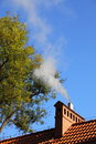 Smoke from a chimney sky blue Royalty Free Stock Photography