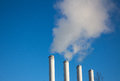 Smoke chimneys factory contaminate the air causing pollution Stock Photography