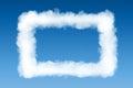 Smoke cloud photo frame on blue sky background Royalty Free Stock Image