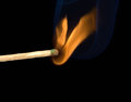 Smoke from a lighted match and blue on black background Royalty Free Stock Images