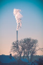 Smoke of pipe in winter sky Royalty Free Stock Photo