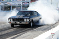 Smoke show napierville dragway august picture of chevelle drag car making a during car at john scotti all out event Royalty Free Stock Photo