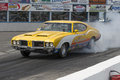 Smoke show napierville dragway july picture of yellow oldsmobile at the starting line making a during nhra national open event Royalty Free Stock Images