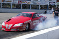 Smoke show nhra national open july – picture of red pontiac drag car making a at the starting line Stock Photography