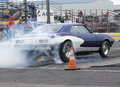 Smoke show rear side view picture of pontiac firebird burning tire during the drag event at napierville dragway Stock Image
