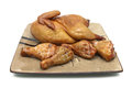 Smoked chicken and grilled chicken legs on the plate Royalty Free Stock Photo