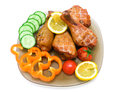 Smoked chicken legs with vegetables and lemon on white backgroun Royalty Free Stock Photo