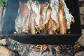 Smoked fish on fire Royalty Free Stock Photo
