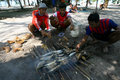 Smoked fish fishermen cook for lunch at cemara island karimun islands central java indonesia Stock Photo