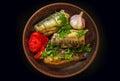 Smoked fish mackerel with vegetables and garlic Royalty Free Stock Photo
