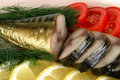 Smoked fish served with vegetables Royalty Free Stock Photo