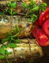Smoked fish with vegetables on a natural clay plate. mackerel Royalty Free Stock Photo