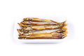 Smoked fishes on a white background Royalty Free Stock Photography