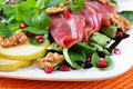 Smoked goose breast on salad Royalty Free Stock Photography