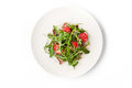 Smoked ham and arugula salad on the white background  top view Royalty Free Stock Photo