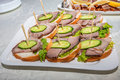 Smoked ham canape on plate Royalty Free Stock Photo