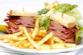 Smoked meat sandwich with frys and ceasar Royalty Free Stock Images